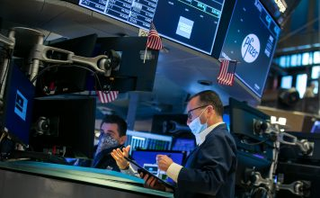 Stocks rise as Wall Street heads for winning week and a historic month